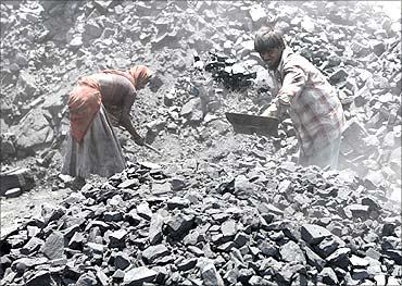 Labourers work at a coal yard on the outskirts of the western Indian city of Ahmedabad.