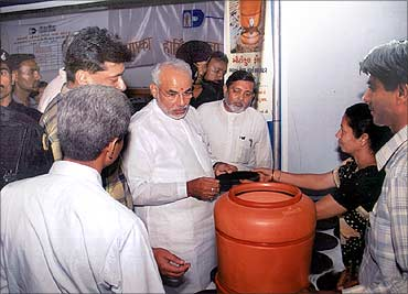 Gujarat Chief Minister Narendra Modi checks the products.
