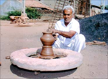 Mansukhbhai's father at work.