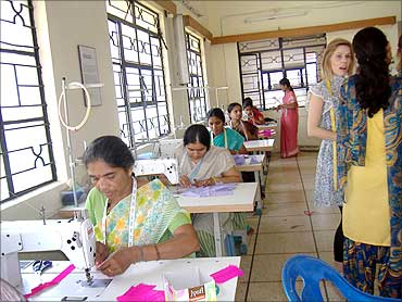 Women get training in tailoring.