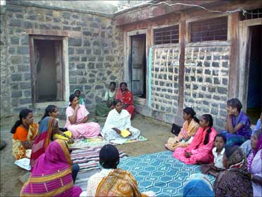 Sinha (seated in a light pink sari) at a self help meeting