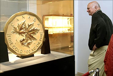 A visitor looks at the world's largest gold coin.
