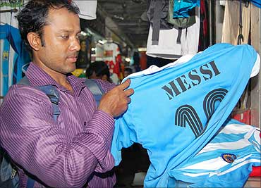 A buyer picks a jersey depicting the Argentinian star footballer Lionel Andres Messi's name.