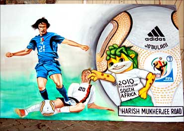 Walls are adorned with World Cup-related paintings.