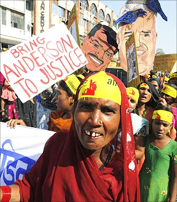 Local activists stage a demonstration to mark the 25th anniversary of the Bhopal gas disaster. Photograph: Reinhard Krause/Reuters