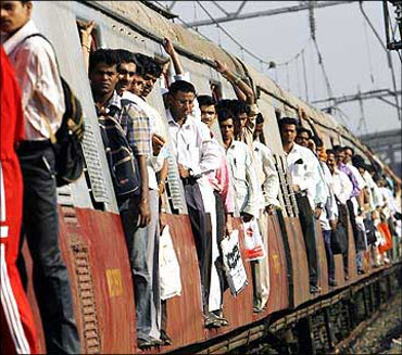 Commuters travel in a suburban train in Mumbai.