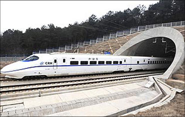 The high-speed train travels on the new Wuhan-Guangzhou railway in Wuhan, Hubei province.