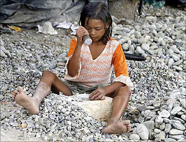 A small girl works at a quarry.