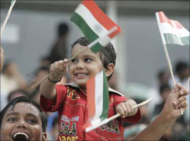 A child waves the Indian national flag.