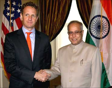 US Secretary of Treasury, Tim Geithner shakes hand with Pranab Mukherjee.