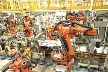 Robots work at Ford plant.