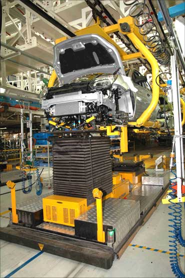 Engine being fitted to a car at the Ford plant in Chennai.
