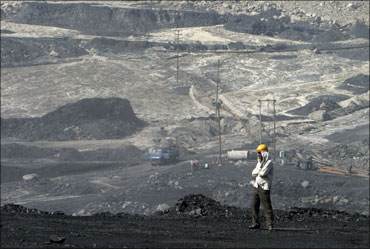 A miner stands at the Gevra coalmines in Chhattisgarh.