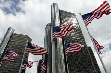 American flags fly in front of General Motors Corp. world headquarters in Detroit, Michigan.