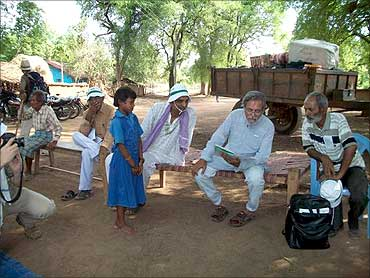 Anil Gupta with villagers.