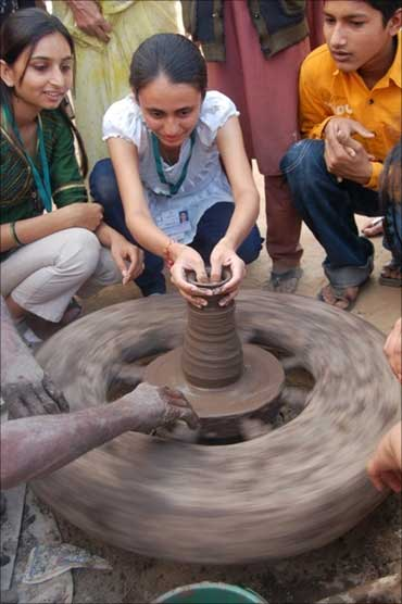 IIM students try their hand at pottery.