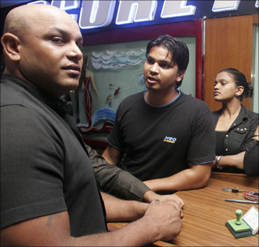 No holds barred: Wrestlers get corporate identity
