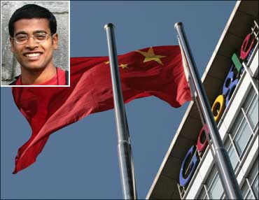 A Chinese national flag flies in front of Google China's headquarters in Beijing. (Inset) Shishir Nagaraja.