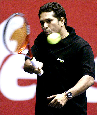 Sachin Tendulkar plays a shot during an exhibition match with Russia's Maria Kirilenko.