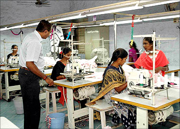 Women stitching clothes at a garments unit in Tirupur.