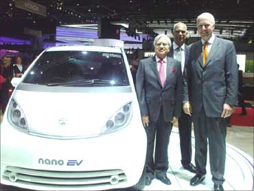 Tata Motors officials with Tata Indica Vista Electric at the Delhi Auto Expo 2010.