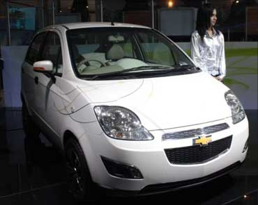 A model poses with Chevrolet E-Spark at the Delhi Auto Show 2010.