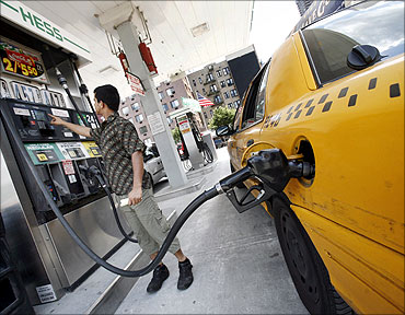 A New York cab driver fills his taxi up with gas at a Hess station.