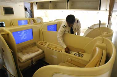 An official looks at the first class cabin section in Air India's Boeing 777-200 LR aircraft.