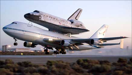 NASA's Space shuttle Discovery, atop a modified 747 carrier aircraft lift off from Edwards Air Force Base, California, en route to the Kennedy Space Center in Florida.
