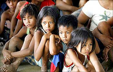 Children from flood-hit town Rosales, Pangasinan wait for the distribution of relief supplies.