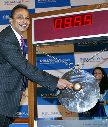 Anil Ambani strikes a gong during the listing of Reliance Power at the Bombay Stock Exchange.