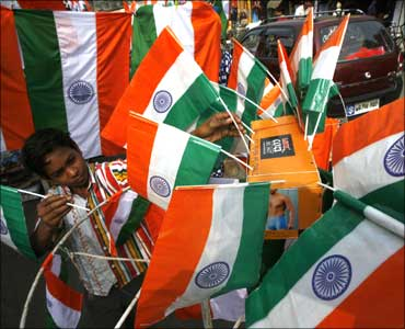 A boy sells Indian flags.