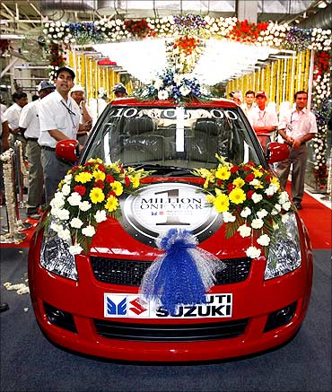 Maruti's millionth baby of the year, a dazzling red Swift.