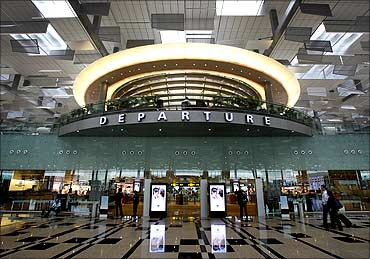 Passengers walk towards their departure gates in Terminal 3 at Singapore's Changi Airport.