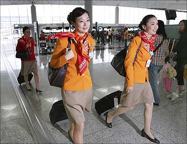 Oasis Hong Kong flight attendants prepare to board a plane at the Hong Kong International Airport.