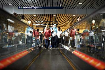 Women use the travelator at Kuala Lumpur airport.