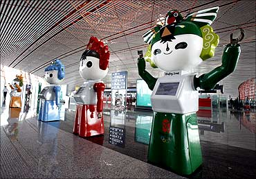 Olympic 'Fuwa' mascots parade at the new Beijing Capital International Airport July 23, 2008.
