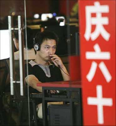 A man uses a computer at an internet cafe in Beijing.