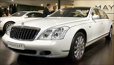 A Maybach 62 S Landaulet limousine is displayed at a car show.