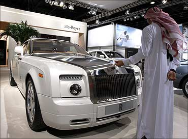 Visitors look at the Rolls Royce Phantom during Dubai Motor Show.