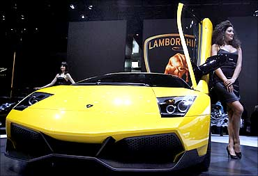 A model poses beside a Lamborghini Murcielago LP 670-4 Superveloce car.