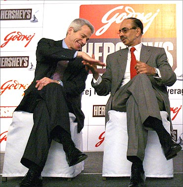 Richard H. Lenny (L), Chairman and Chief Executive Officer of Hershey Co., and Adi Godrej (R).