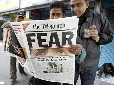 People reading  The Telegrpah newspaper.