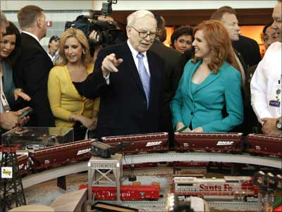 Buffett talks in front of BNSF model railroad. BNSF was bought by Berkshire Hathaway in February.