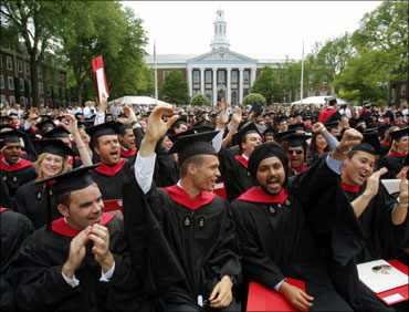Harvard Business School students cheer during their graduation ceremonies in Boston, Massachusetts.
