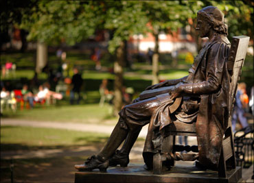 The statue of John Harvard sits in Harvard Yard at Harvard University in Cambridge, Massachusetts.