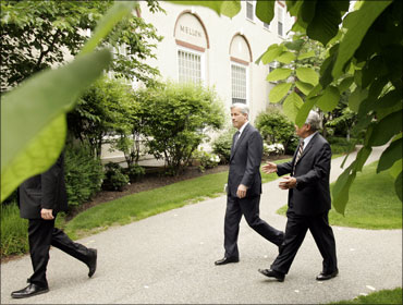 JP Morgan Chase CEO Jamie Dimon (C) walks to Harvard Business School Class day events.