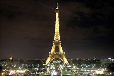 The Eiffel Tower is pictured before Earth Hour in Paris.