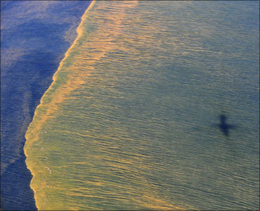 Oil is seen on the surface of the Gulf of Mexico in an aerial view of the Deepwater Horizon oil spill off the coast of Mobile, Alabama.