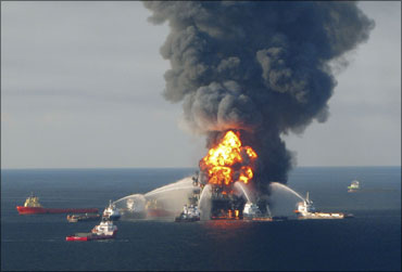 Fire boat response crews battle the blazing remnants of the off shore oil rig Deepwater Horizon, off Louisiana.